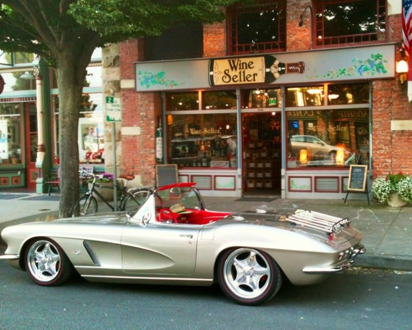 corvette in front of shop
